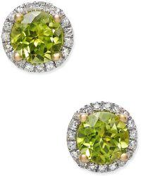Macy's - Peridot (1-3/4 Ct. T.w.) And Diamond (1/6 Ct. T.w.) Halo Stud Earrings In 14k Gold - Lyst