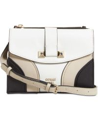 5d6d739a176 Lyst - Guess Cate Convertible Crossbody Flap in Natural