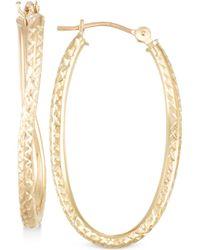 Macy's - Textured Twisted Oval Hoop Earrings In 10k Gold - Lyst