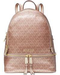 d83b9e09ff496 Michael Kors - Michael Metallic Signature Rhea Zip Backpack - Lyst