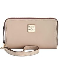 Dooney & Bourke - Beacon Zip Around Wristlet - Lyst
