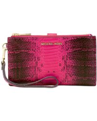 0ab7a0c9e10ef Lyst - Michael Kors Michael Bedford Large Zip Clutch in Red