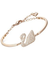 Swarovski - Rose Gold-tone Crystal Swan Bangle Bracelet - Lyst