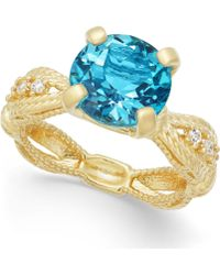 Macy's - Swiss Blue Topaz (3-1/2 Ct. T.w.) & Diamond (1/10 Ct. T.w.) Ring In 14k Gold-plated Sterling Silver - Lyst