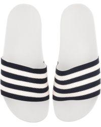12c743522 Lyst - adidas Originals Adilette Slides in White for Men