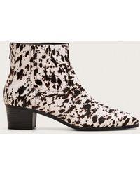 93e7e4ba4c0 Animal Print Leather Ankle Boots - White