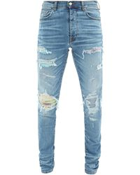 Amiri Floral-patch Distressed Slim-leg Jeans - Blue