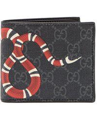 dae68c537733e9 Lyst - Ferragamo Snake Embossed Leather Wallet in Black for Men
