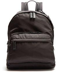 Prada - Zip Pocket Leather Trimmed Backpack - Lyst