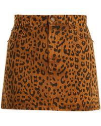 Saint Laurent - Leopard-print Denim Mini Skirt - Lyst