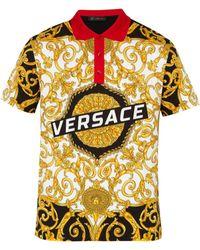 Versace - Polo en coton à imprimé Gold Hibiscus - Lyst 5d38e5830e4