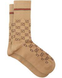 Gucci Chaussettes en coton mélangé à logo Suprême GG - Neutre