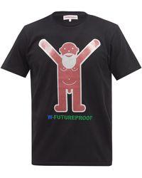 Walter Van Beirendonck T-shirt en jersey de coton à imprimé logo - Noir
