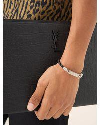Saint Laurent Bracelet en cuir torsadé à plaque logo - Multicolore