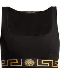 fdc976ca3bf04 Versace Greek Key Sports Bra in Black - Lyst