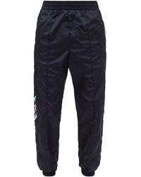Versace グレカパターン&ストライプ シェルトラックパンツ - ブルー
