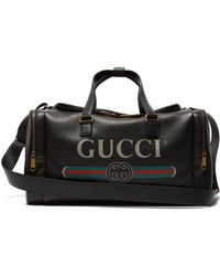 9b0dbf7b714 Gucci Kingsnake Print Leather Duffle in Black for Men - Lyst