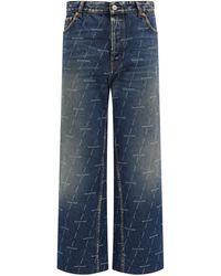 Balenciaga Monogram-logo Cropped Jeans - Blue