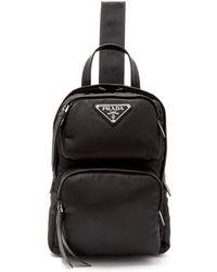 1de7234ca088 ... cheapest prada nylon single strap cross body backpack lyst 543ea ef668