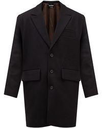 Jacquemus Manteau oversize en laine vierge à boutonnage - Noir