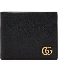 Gucci Portefeuille en cuir à deux volets GG Marmont - Noir