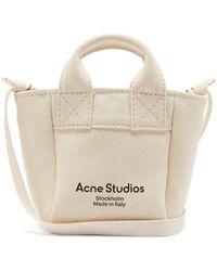 Acne Studios Aleah Logo-print Cotton-canvas Cross-body Bag - Natural
