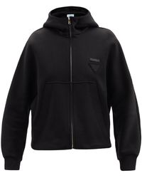 Prada Sweat-shirt en coton mélangé à capuche et logo - Noir