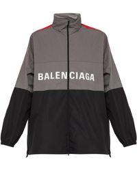 Balenciaga Veste de jogging en tissu imperméable à logo - Gris