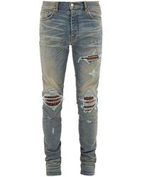 Amiri Mx1 Animal-insert Distressed Skinny-leg Jeans - Blue