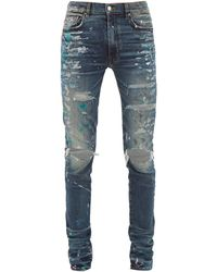 Amiri Paint Splatter Distressed Slim Leg Jeans - Blue