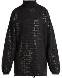 Balenciaga Sweat-shirt en coton mélangé oversize à imprimé - Noir