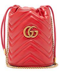 Gucci Sac seau en cuir GG Marmont - Rouge