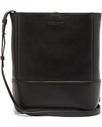 Bottega Veneta - Logo-debossed Leather Bucket Bag - Lyst
