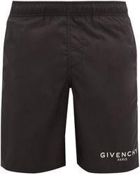 Givenchy Short de bain en satin à imprimé logo - Noir