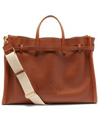 Valentino Garavani Logo-debossed Leather Tote Bag - Brown