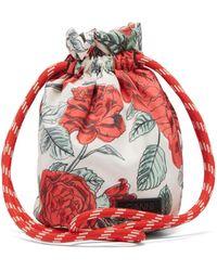 Ganni Sac seau en tissu imperméable à imprimé floral - Rouge