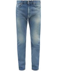 Kuro Helvetica Slim-leg Jeans - Blue