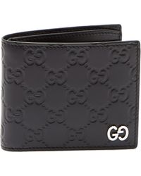 Gucci - GG-debossed Bi-fold Leather Wallet - Lyst