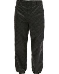 Gucci Stirrup-cuff Gg-print Technical Trousers - Black