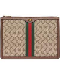 Gucci - Pochette en toile et cuir Suprême GG - Lyst