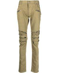 Balmain Skinny-Jeans in Distressed-Optik - Grün