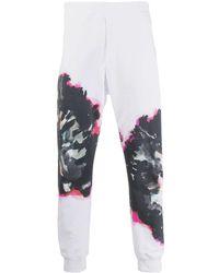 Alexander McQueen Jogginghose mit abstraktem Print - Weiß