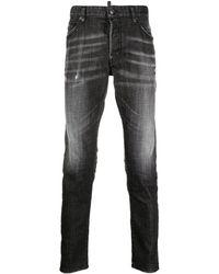 DSquared² Schmale Distressed-Jeans - Schwarz