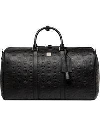 MCM Traveller Weekender In Monogram Leather - Black