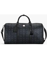 MCM Traveller Weekender Bag In Visetos - Black
