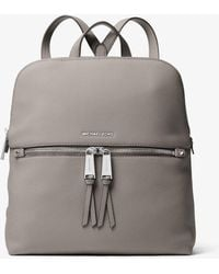 46e18145e229 Michael Kors Rhea Medium Slim Logo Backpack in Natural - Lyst