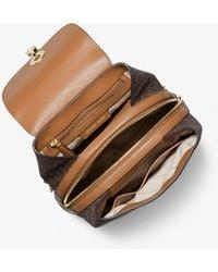 Michael Kors Mk Raven Medium Logo And Pebbled Leather Backpack - Brown