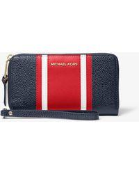 Michael Kors - Large Striped Pebbled Leather Smartphone Wristlet - Lyst