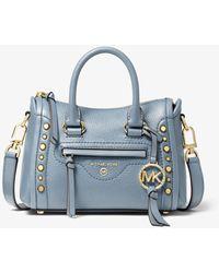 Michael Kors Carine Extra-Small Studded Pebbled Leather Crossbody Bag - Blau