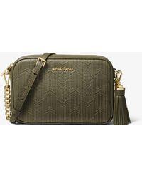 2a86127e133b MICHAEL Michael Kors - Ginny Medium Deco Quilted Leather Crossbody Bag -  Lyst